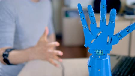 replication : An engineer making fists to test bionic hand.