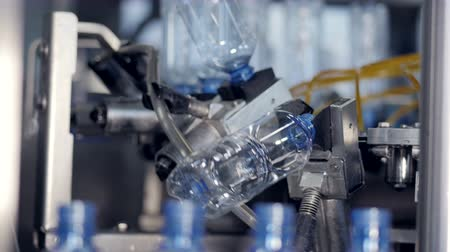 clear liquid : The process of bottled water production. Bottles being prepared to be filled with water. Stock Footage