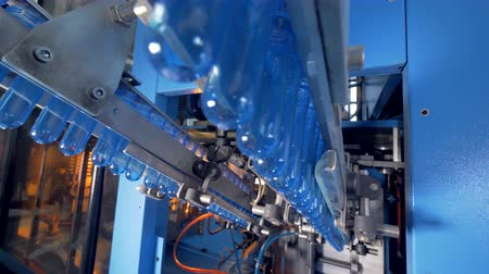 drinking water supply : Tubes of PET being prepared to be transformed into bottles. Stock Footage