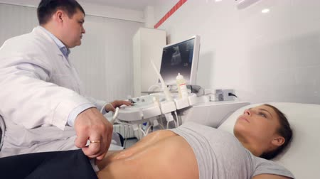 pregnant woman ultrasound : Aerial close up of ultrasound examination of the abdominal cavity Stock Footage