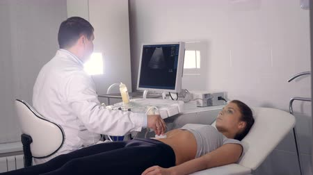 pregnant woman ultrasound : Aerial of of ultrasound examination of the abdominal cavity Stock Footage