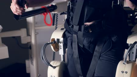 fulllength : A man inside a VR suit tests body movements.