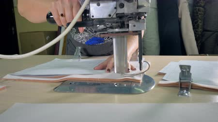 süet : A tailor cuts a pattern on double layer cloth.