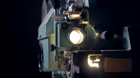 video reel : Old-fashioned movie projector in operation.