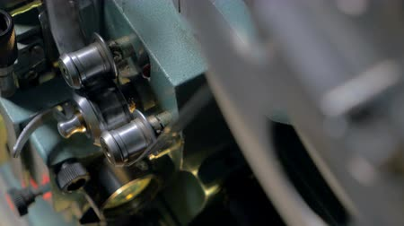 video reel : Tape going through opto-mechanical film projector. Stock Footage