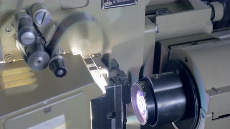 video reel : Out-of-date film projector in operation. Stock Footage