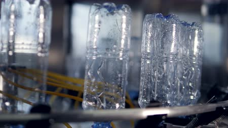 continuity : Water bottles bottoms up during washing. Stock Footage