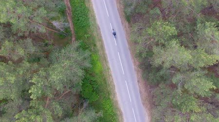 kilometer : View from above of a biker riding his motorcycle. Stock Footage