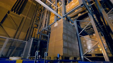 A full pallet moving and turning on a conveyor.