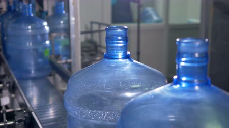 plastic processing : New batch of large PET bottles on line. Stock Footage