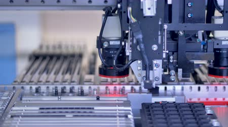 solder : Electronic circuit board production on modern automated machine.