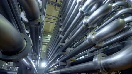 miktar : Endless curving pipes at a dairy factory.