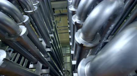 miktar : Close-up on steel water pipes at a dairy factory. Stok Video