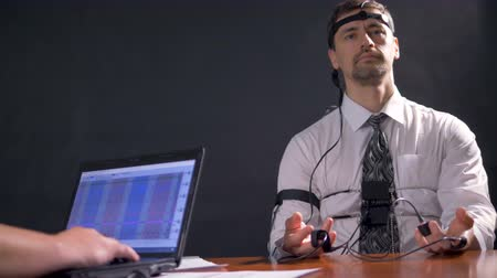 interrogation : A low view on a relaxed polygraph device.