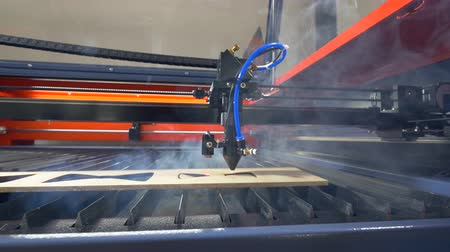 emergency stop : Laser cutting machine in ation. 4K.