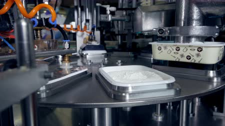 cheese types : Automated production line of milk products at cheese plant. Stock Footage