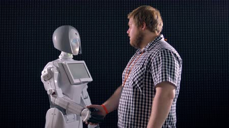 resourceful : A handshake between a man and a robot. Stock Footage