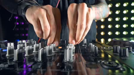 toggle : A DJ mixer adjustment process in detail. Stock Footage
