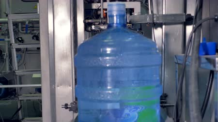 drinking water supply : Fast motion of water bottles refilled and moved away. Stock Footage