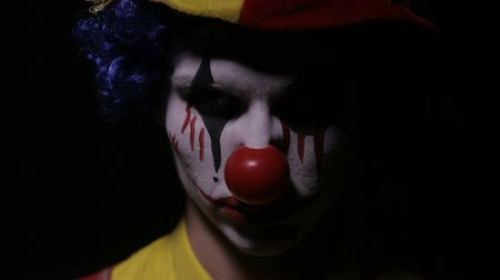 scary clown : A closeup of an angry clowns face. Stock Footage