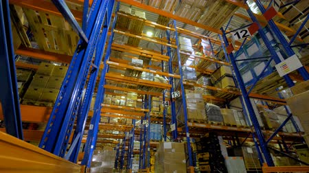 sending : Big indutrial warehouse interior. Storage facility with no people. 4K.