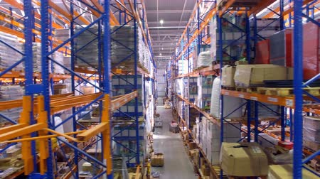 stockpile : Warehouse interior. Camera is moving along shelfs. Aerial. 4K. Stock Footage