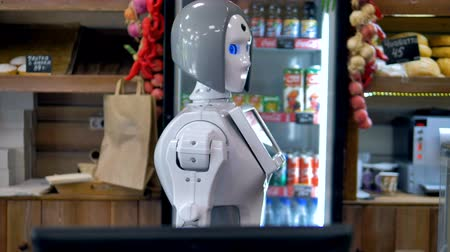 bot : A robot works at the bakery counter.