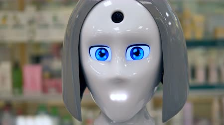 бдительность : A new shiny robot blinks with its large blue eyes.