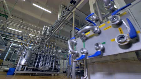 drinking water supply : A detailed view on control valves for a pasteurization room.