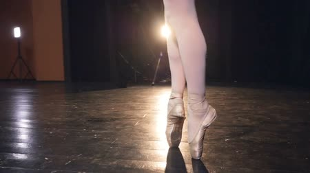 aşınmış : Dancing ballerinas feet in stockings and pointe shoes.