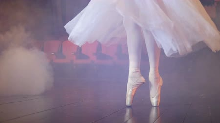 fogged : Dancing ballerinas feet in a fogged room.