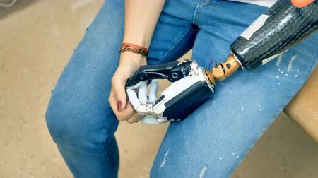 ergonomic : Woman demonstrates her robotic bionic hand. 4K.