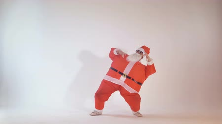 teen action : Cheerful Santa Claus dancing as a teenager. 4K. Stock Footage