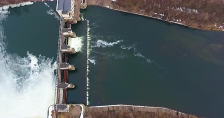 architectural protection : High water in spring. Water discharge at the dam Aerial. Stock Footage