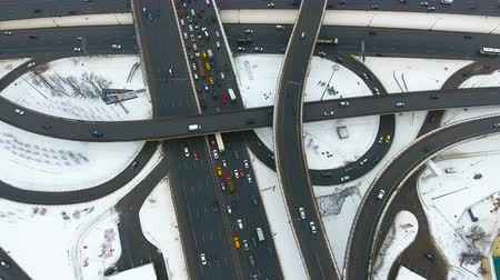 interchange : A high angle on a busy intersection. Stock Footage