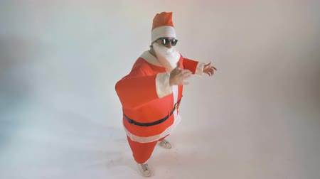 beckoning : Santa in sunglasses makes beckoning gestures. Invitation Concept.