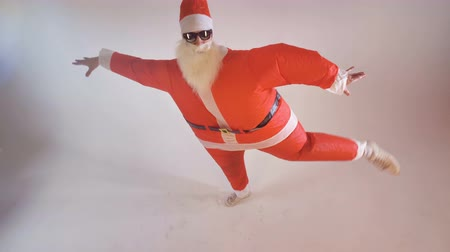 newyear : Santa Claus artist makes silly ballerina moves.