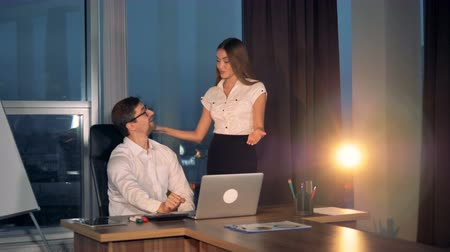 cooperative work : A businesswoman gives ideas to a businessman with a laptop.