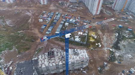 estate agency : A camera rotating around a blue tower crane at a construction site. Stock Footage