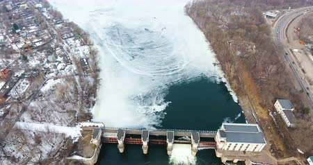 architectural protection : Opened barriers on a city river dam. High water in spring. Aerial.