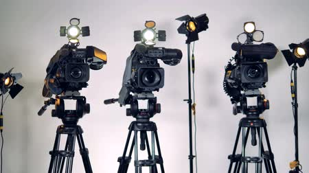 television set : A row of different video equipment.