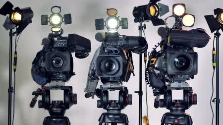 ayarlanabilir : Several video cameras installed on heavy tripod heads. Stok Video
