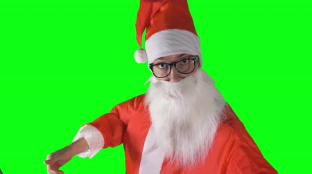 dev : A close-up on Santa Claus pointing to the camera and beckoning. Stok Video