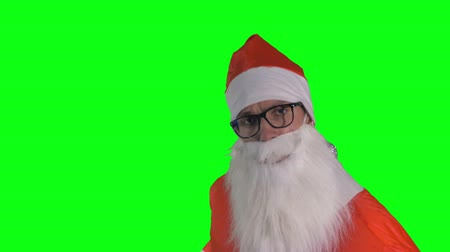 caricatura : A chroma key background with a Santa Claus promoter.