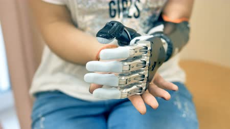 hi fi : Female using futuristic robotic cyborg arm. Real modern medical robotic prosthesis. Stock Footage