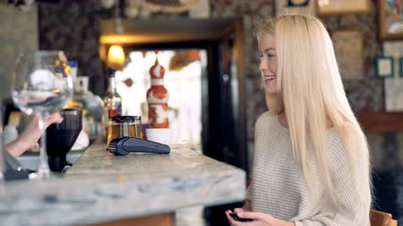 nfc : Attractive female at cafe making online payment using smartphone. 4K. Stock Footage