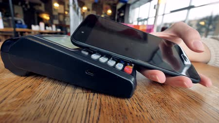 payment : A close-up view of a POS NFC terminal in use.