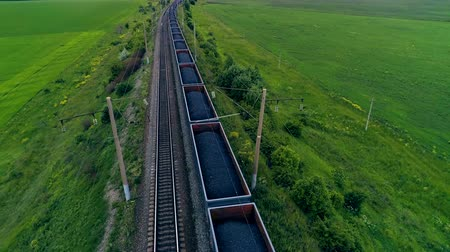 siding : Big cargo train transporting coal. Aerial shot. Close-up.