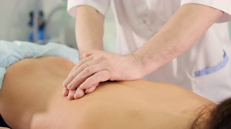 therapeutic : Close up of the massage therapist massaging womans back Stock Footage