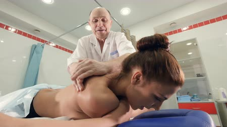 tatoo : Low angle of  the massage therapist and the young woman Stock Footage